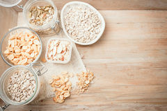 Various nuts and seeds on wooden background, top view Stock Image