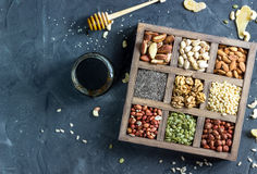 Various nuts and seeds in a wooden box stock photos