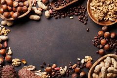 Various nuts on stone table stock photography