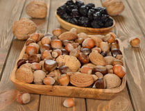Various nuts in a wooden bowl Stock Images