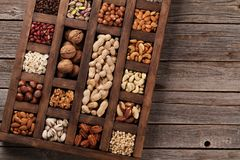 Various nuts in wooden box royalty free stock photography