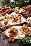 Various nuts. On wooden table Stock Photography