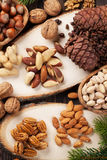 Various nuts on wooden table Royalty Free Stock Image