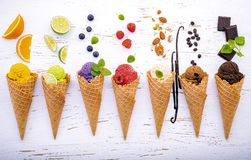 Free Various Of Ice Cream Flavor In Cones Blueberry ,lime ,pistachio ,almond ,orange ,chocolate ,vanila And Coffee Setup On Shappy Royalty Free Stock Images - 164395099