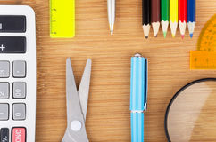 Various office supplies on wooden table Royalty Free Stock Photos