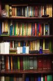 Various Old Books On Shelves. Closeup view of old closet full of old books Royalty Free Stock Photo