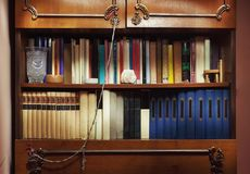 Various Old Books On Shelves. Closeup view of old closet full of old books Stock Photo