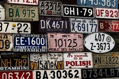 Various old car license plates from around the world at the muse Stock Image