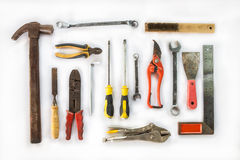 Various old craftsman tools on white Royalty Free Stock Photo