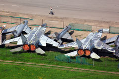 Various old jet fighter airplanes standing at closed airport. Royalty Free Stock Photo