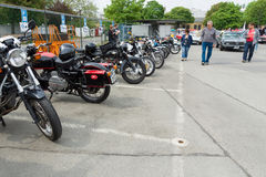 Various old motorcycle standing in a row Stock Photos