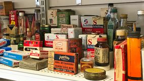 Various old vintage obsolete collectible items on thrift store shelf stock image