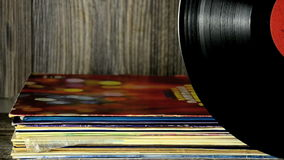 Various old vinyl records on the old wooden background stock video