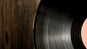 Various old vinyl records on the old wooden background stock video footage