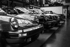 Various oldtimers 60-70s standing in a row Royalty Free Stock Images