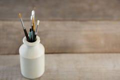 Various paintbrush in a ceramic jar Royalty Free Stock Photo
