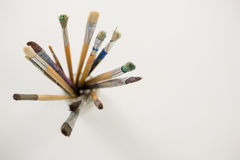 Various paintbrush in a jar Stock Images