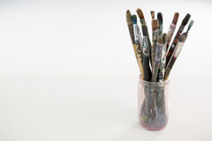 Various paintbrush in a jar Stock Image