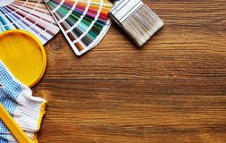 Various painting tools and color palette on wooden background.  Royalty Free Stock Photography