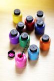 Various paints on a table Stock Photography