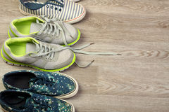 Various pairs of colorful sneakers laid. Stock Image
