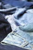 Jeans Background. Various pairs of jeans pants scattered in chaos Royalty Free Stock Photo