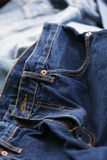 Jeans Background. Various pairs of jeans pants scattered in chaos Stock Photography
