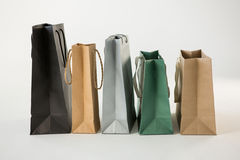 Various paper shopping bags in row Stock Photography