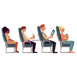 Various passengers, man and women in airplane seats Royalty Free Stock Image
