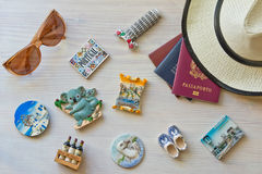 Various passports and souvenir. Magnets from several world country stock photos