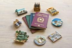 Various passports and souvenir magnets Stock Image