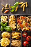 Various pasta in black wooden box Royalty Free Stock Image
