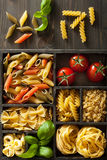Various pasta in black wooden box Stock Photo