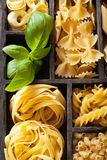 Various pasta in black wooden box Royalty Free Stock Photography
