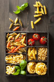 Various pasta in black wooden box Stock Photography
