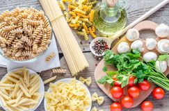 Various pasta with mushrooms and cherry tomatoes Royalty Free Stock Images