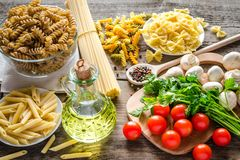 Various pasta with mushrooms and cherry tomatoes Royalty Free Stock Photos