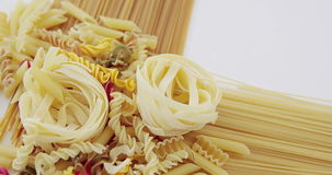 Various pasta and spaghetti on white background. Close-up of various pasta and spaghetti on white background stock video footage
