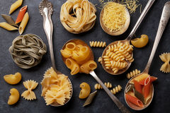 Various pasta on spoons Royalty Free Stock Photography