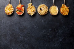 Various pasta on spoons Stock Image