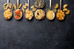 Various pasta on spoons Royalty Free Stock Photo