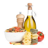Various pasta, tomato and condiments Stock Photo