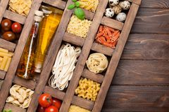 Various pasta in wooden box royalty free stock image