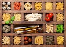 Various pasta in wooden box Stock Photos