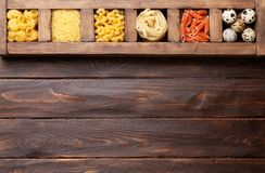 Various pasta in wooden box Stock Photo