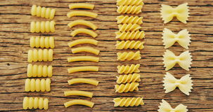 Various pasta on wooden table. Close-up of various pasta on wooden table stock video footage