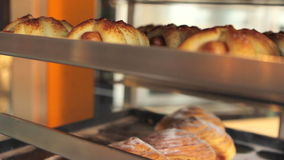 Various pastries on shelving. Different pastry made of batter on the shelf stock footage