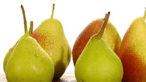 Various pears. On white background stock video footage