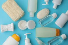 Free Various Personal Care Products. Face Cream, Soap, Lotions, Cotton Pads And Sticks On A Blue Phone. Spa. Top View Royalty Free Stock Images - 174072509