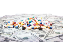 Various pharmaceuticals on dollar notes. All on white background royalty free stock images